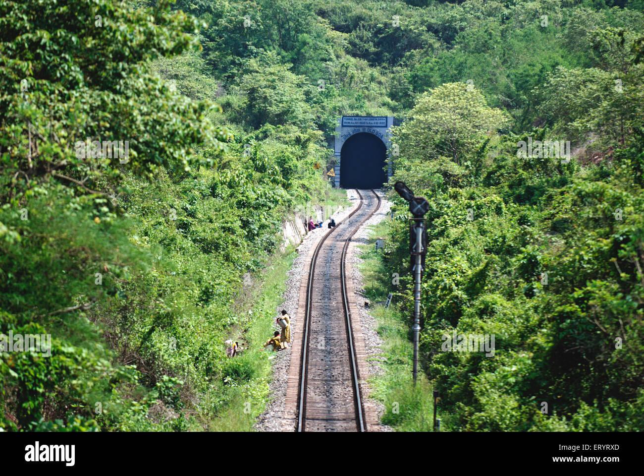 Konkan railroad through trees toward tunnel ; Ponda ; Goa ; India 7 May 2008 Stock Photo