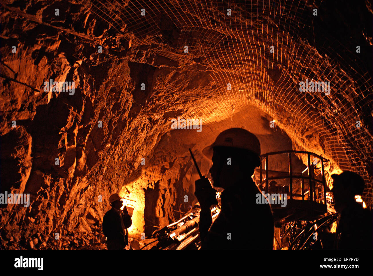Engineers inspect tunnelling at site of hydroelectric project ; Uri ; Jammu and Kashmir ; India 6 April 2008 - Stock Image