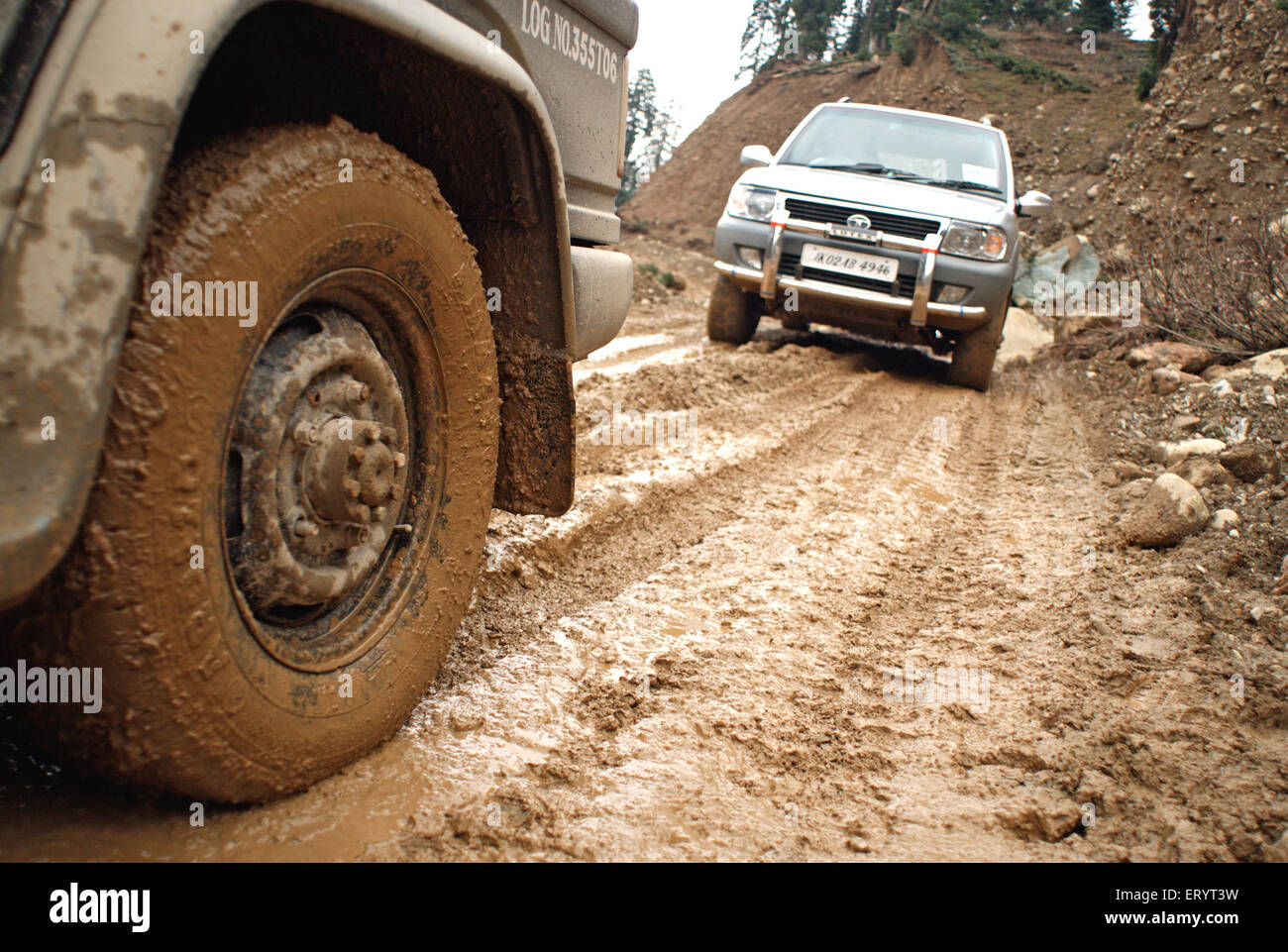 Vehicle on muddy under constructed mughal road ; Jammu and Kashmir ; India 8 April 2008 - Stock Image