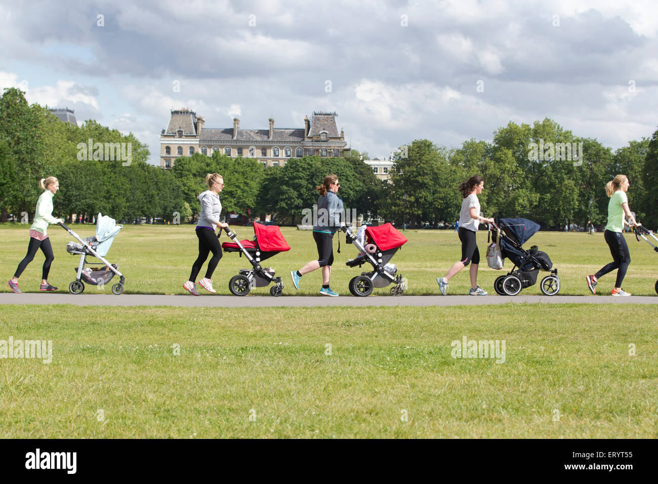 Mother's taking an exercise class with baby and toddler's in their buggies at a park in London, England, - Stock Image