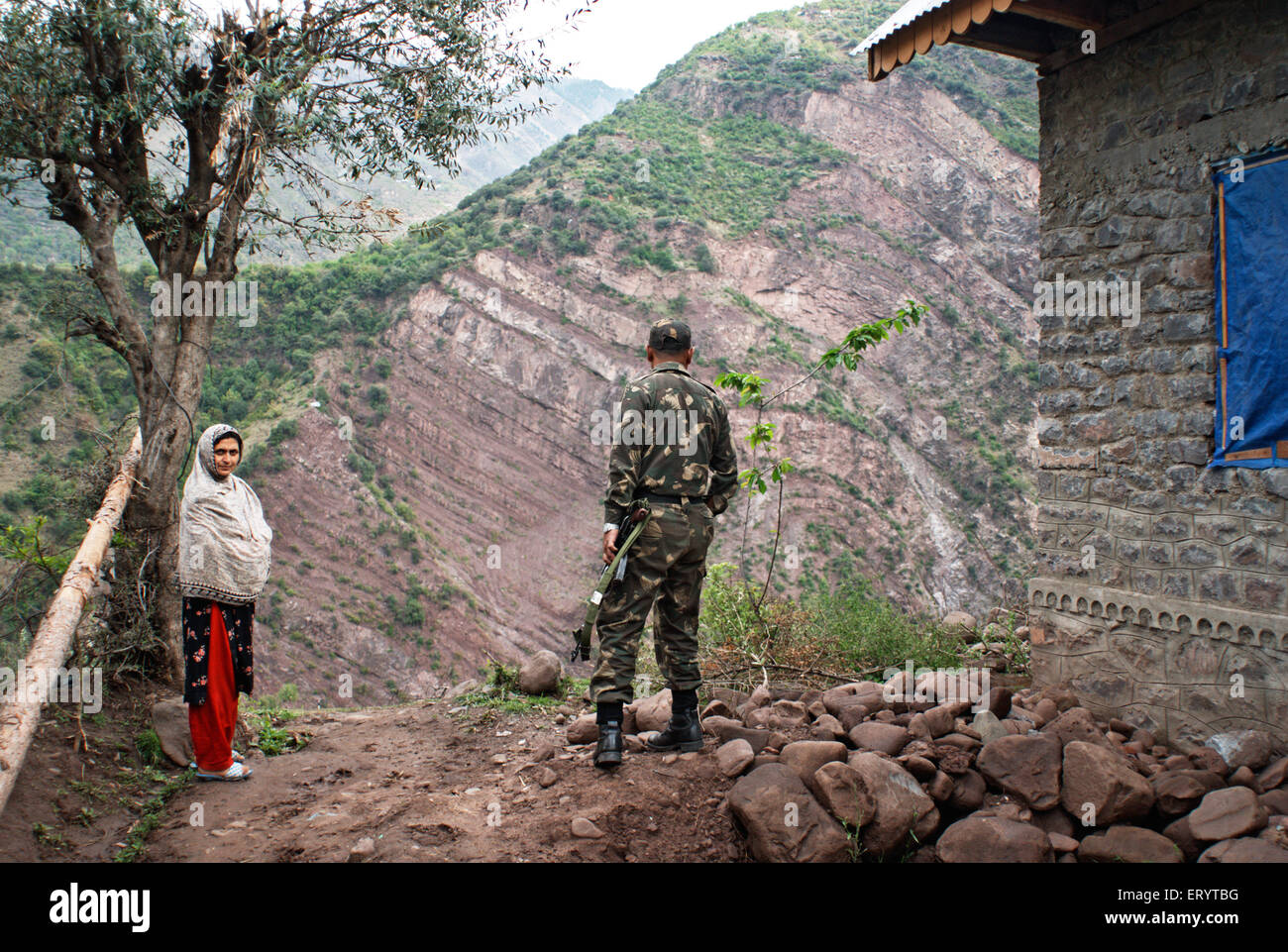 Border security force soldier with woman of Urusa ; Uri ; Jammu and Kashmir ; India  NO MR 7 April 2008 - Stock Image