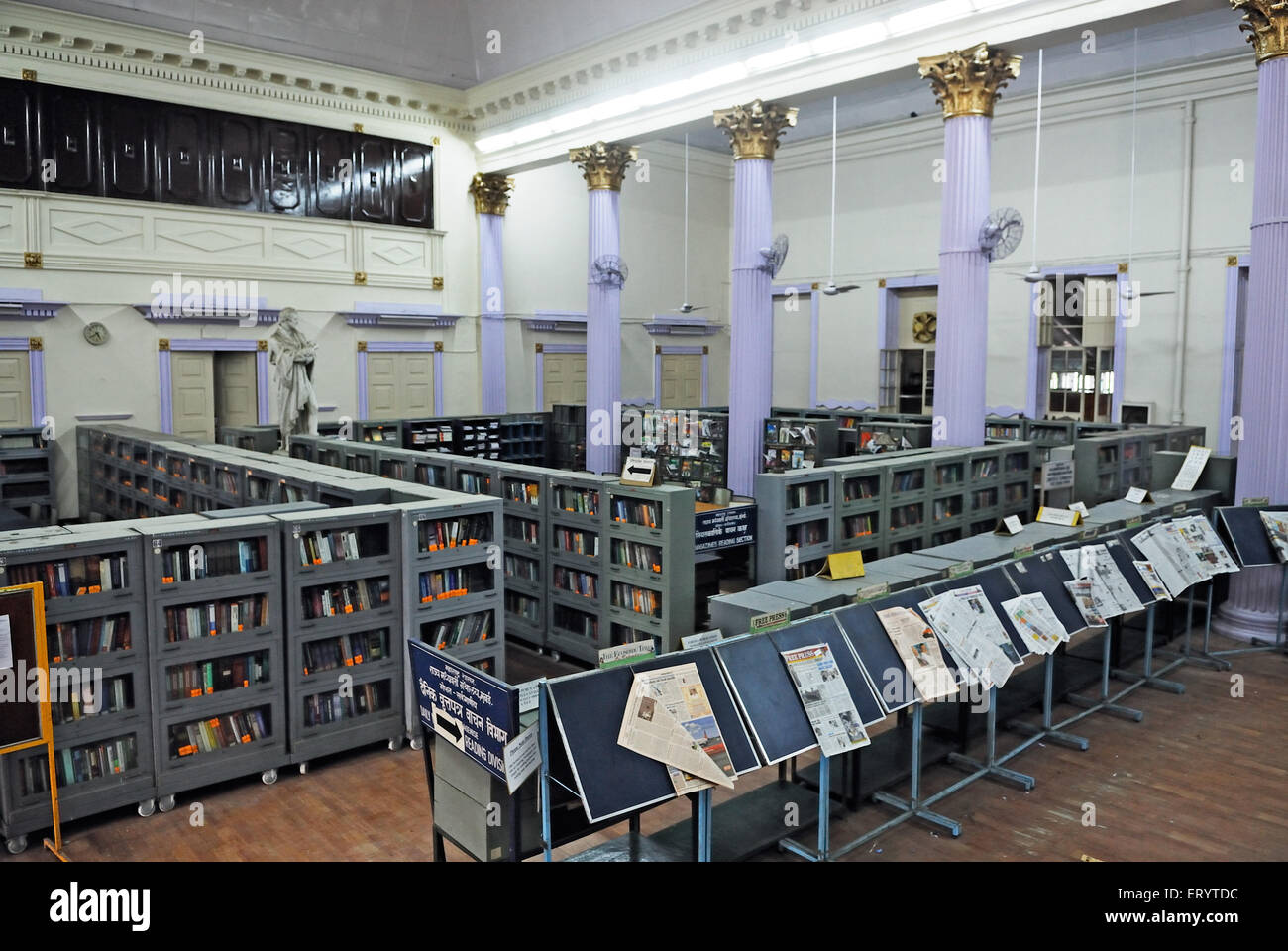 Newspaper stand and book shelves in town hall asiatic library Bombay Mumbai ; Maharashtra ; India - Stock Image