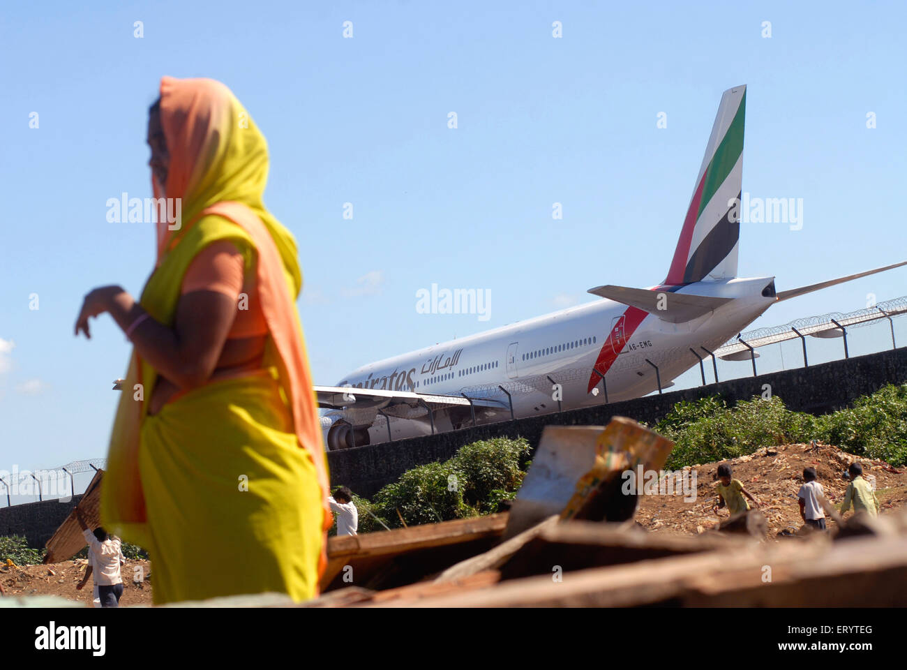 Slum dwellers lookout belongings after demolition of slums on Sahar airport Chatrapati Shivaji International airport - Stock Image