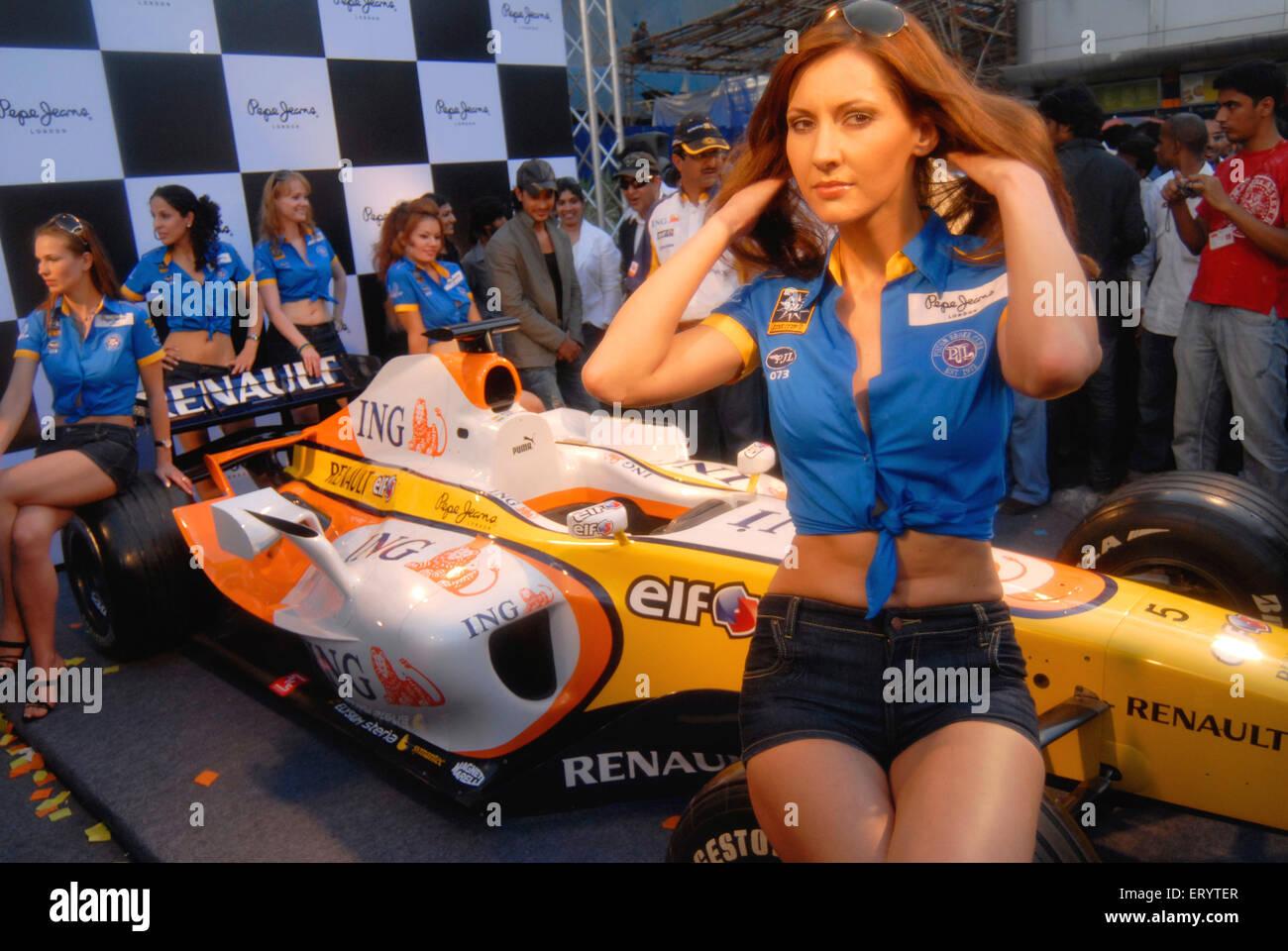 Models display F1 car ; Bombay Mumbai ; Maharashtra ; India NO MR - Stock Image