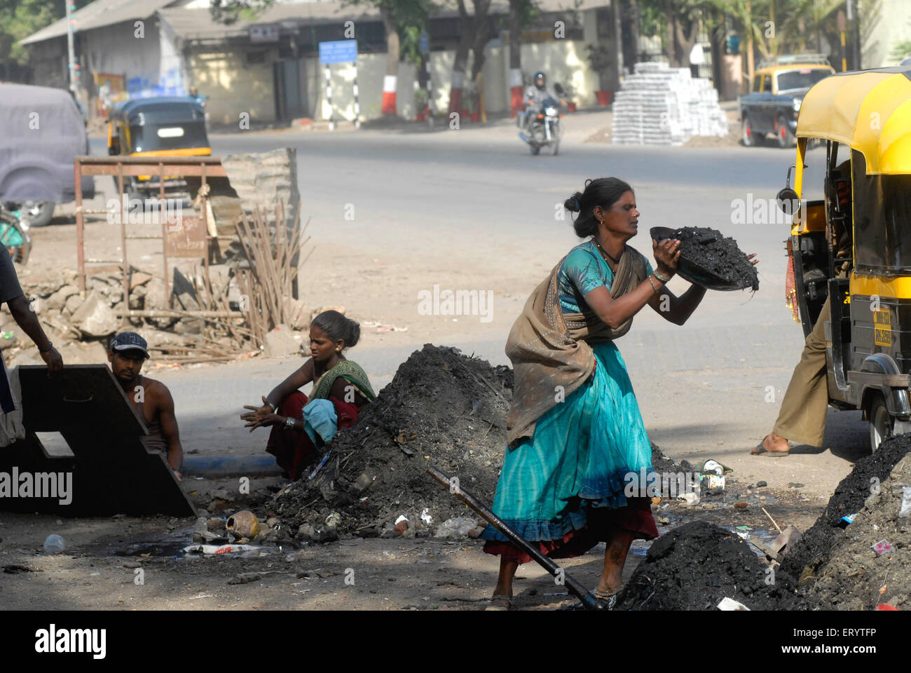 Worker cleaning sewage drains part of monsoon preparations to prevent flooding in Bombay Mumbai ; Maharashtra ; - Stock Image