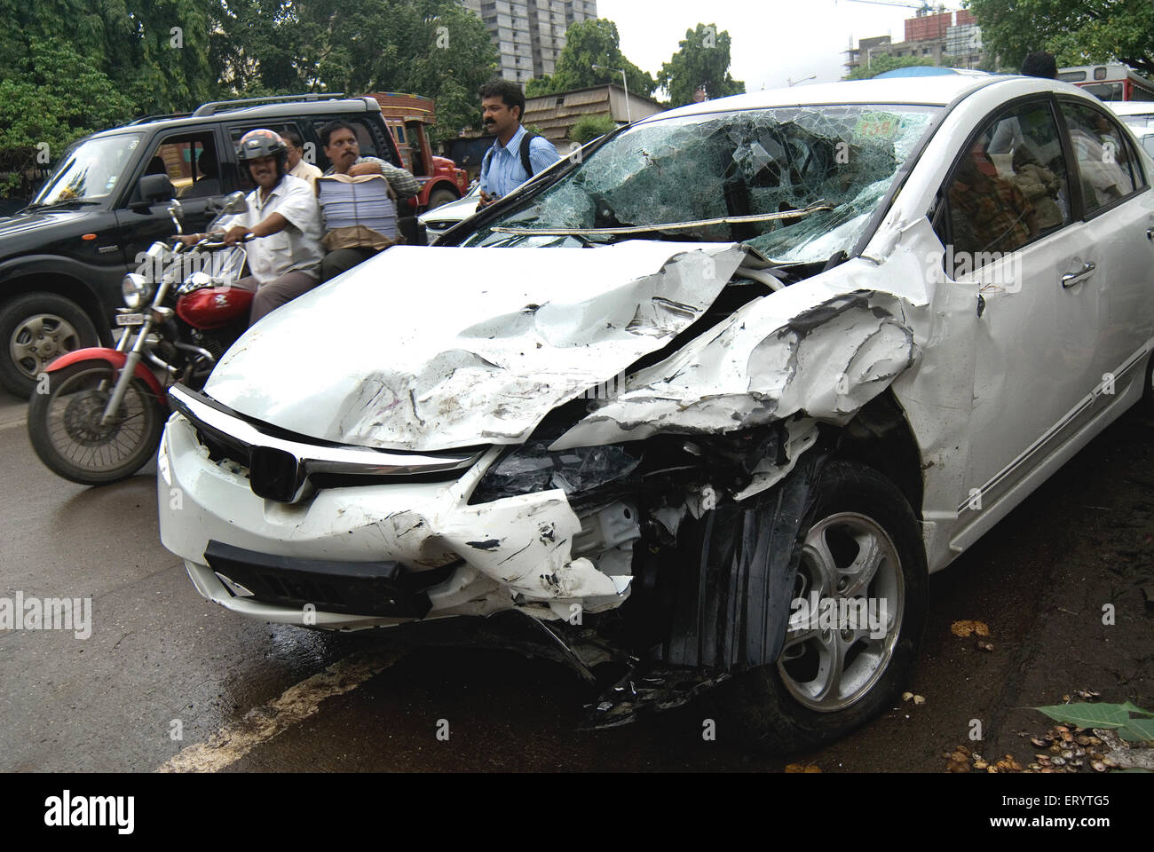 People Watching Car Damaged In Accident At Bombay Mumbai Stock Photo