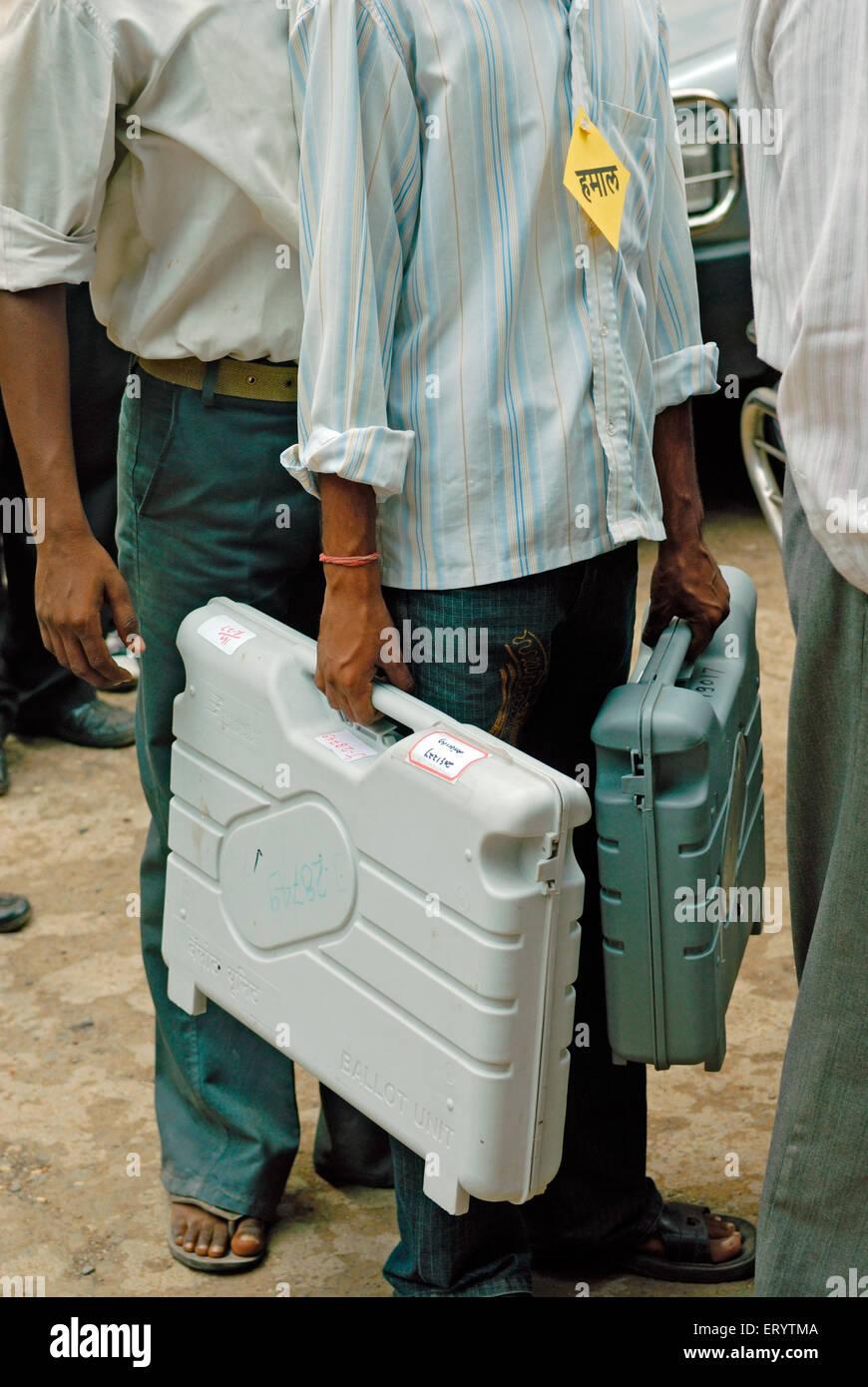 Polling officer carry ballot box Bombay ; Mumbai  ;  Maharashtra  ; India 13 10 2009 - Stock Image