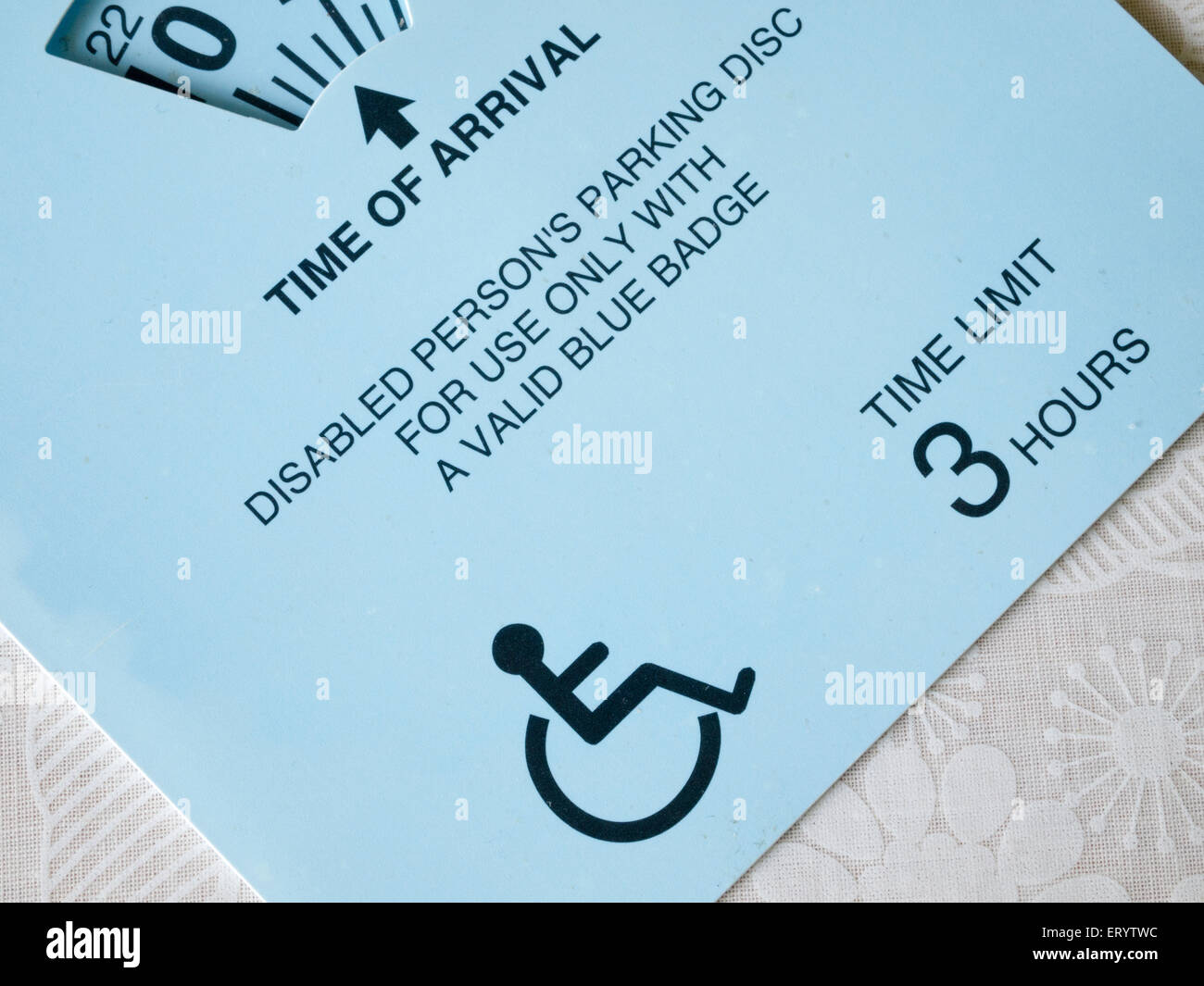 Disabled persons parking disc and permit (blue badge) - Stock Image