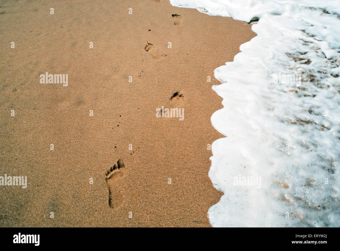 Footprints at Anjuna beach Goa  ; India - Stock Image