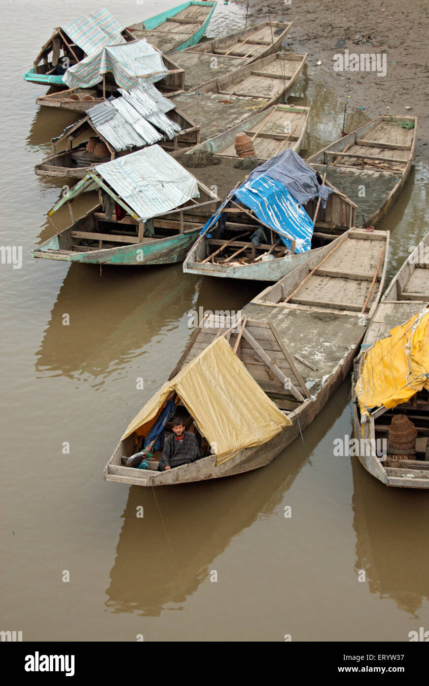 Sand excavating boats on the Jhelum river  ;  Sopore  ;  Baramulla District  ;  Jammu and Kashmir  ;  India NOMR - Stock Image