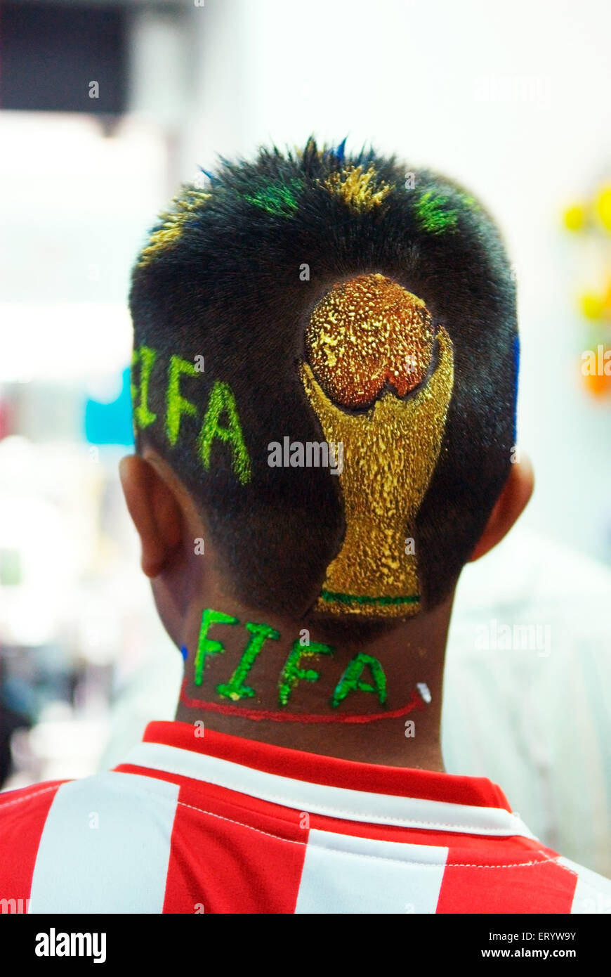 Football fan with trendy haircut during FIFA worldcup - aum 175646 - Stock Image