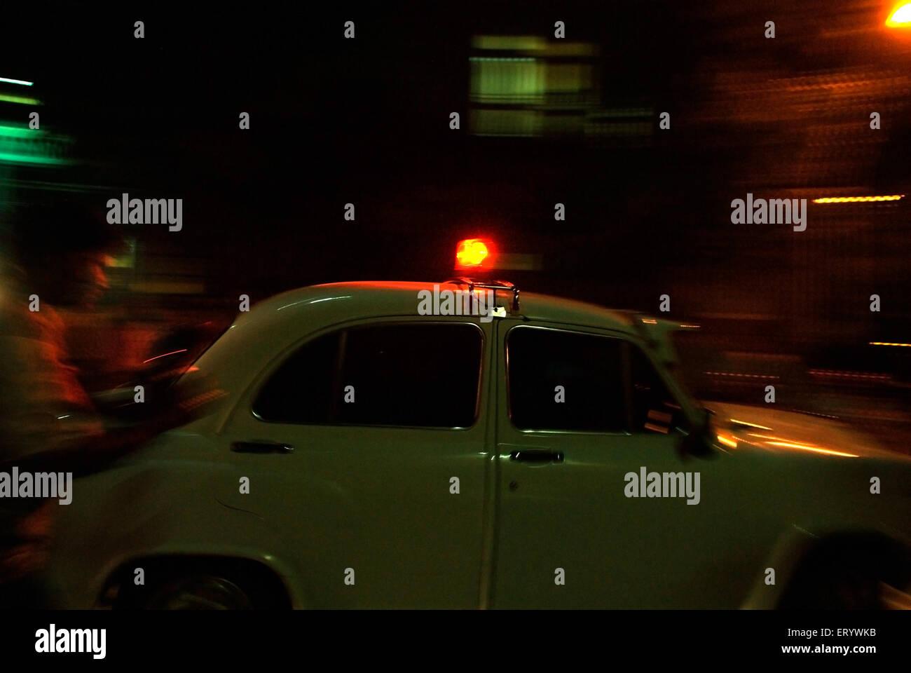 Ambassador car with red siren top Bombay Mumbai ; Maharashtra ; India - Stock Image