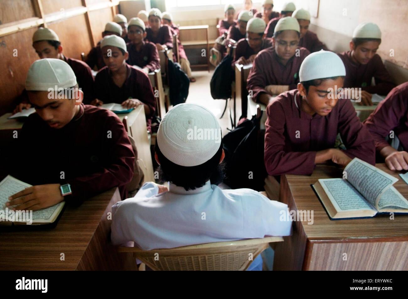 Boys reciting quran in islamic school Bombay Mumbai ; Maharashtra ; India NOMR - Stock Image