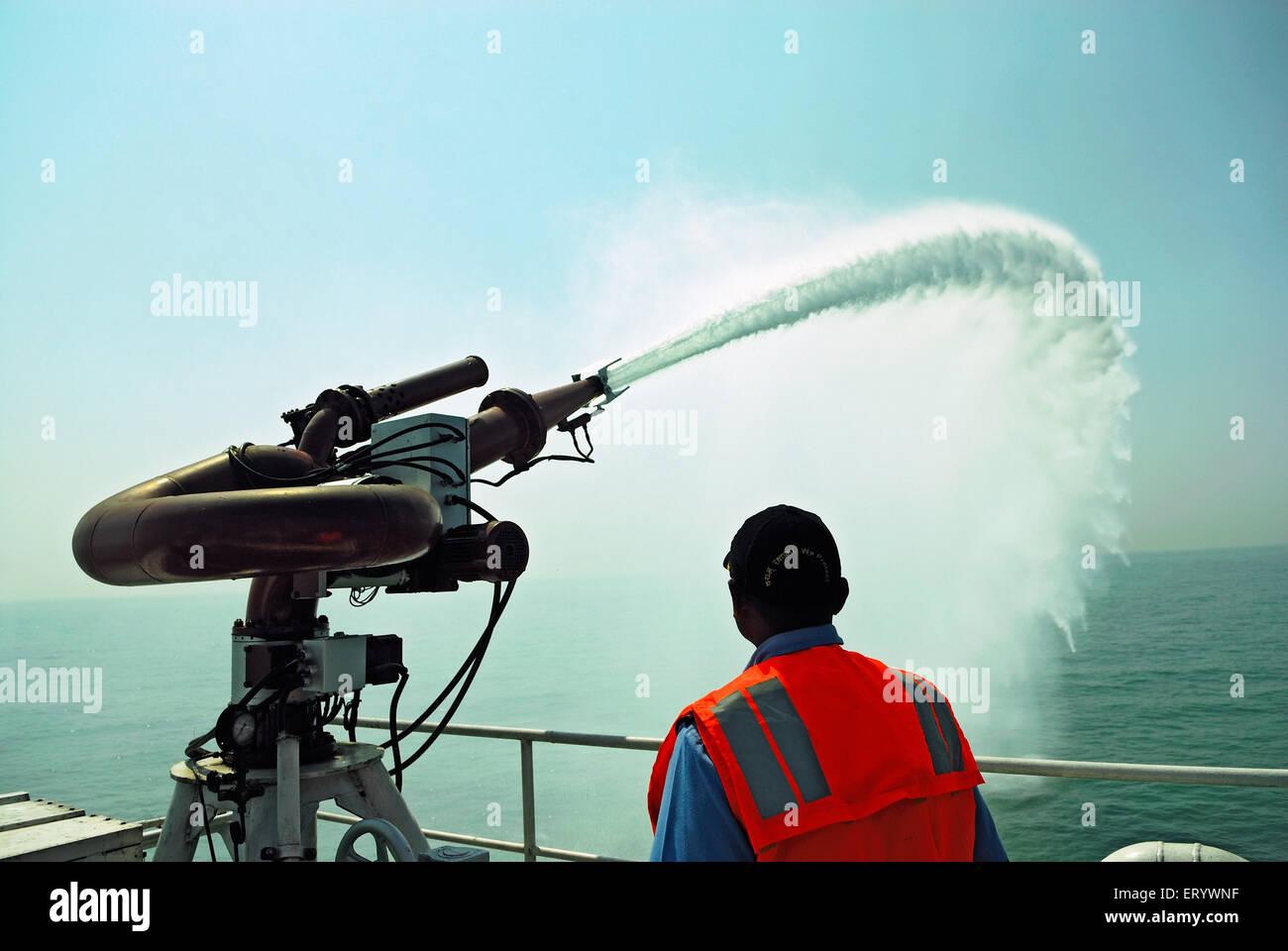 Water cannon on coastguard vigilance ship  ; Bombay Mumbai  ; Maharashtra  ; India - Stock Image