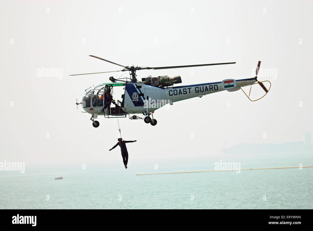 Coastguard on rescue operation Bombay ; Bombay  ; Mumbai  ; Maharashtra  ; India - Stock Image