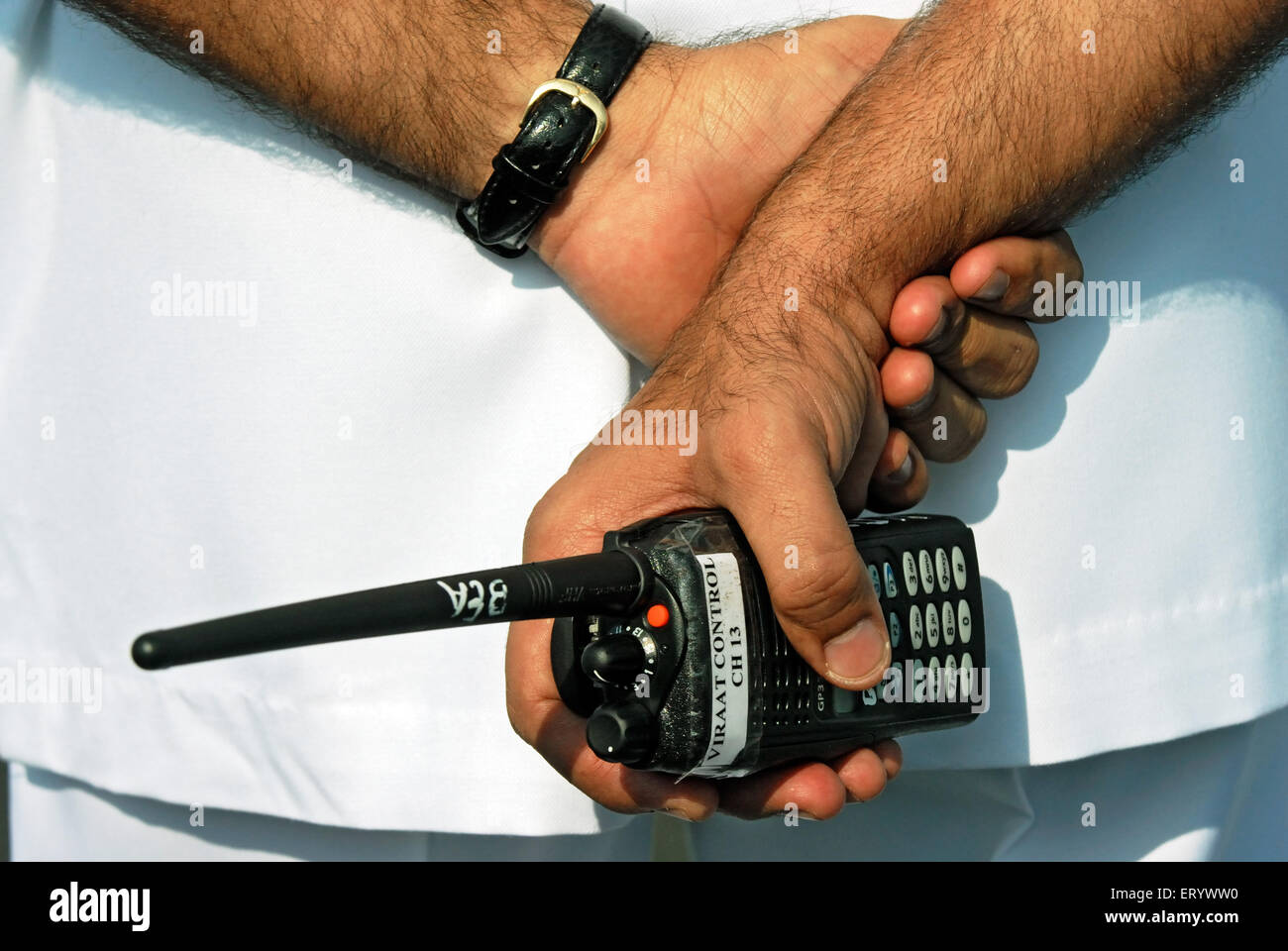 Indian navy officer holds wireless walkie talkie ; Bombay ; Mumbai ; Maharashtra ; India - Stock Image