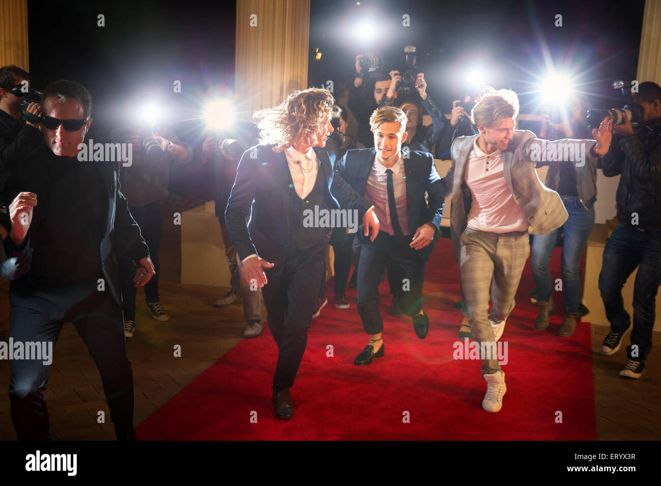 Enthusiastic Celebrities Arriving And Running From Paparazzi At Red