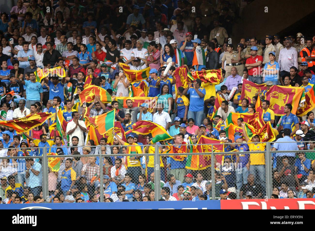 Sri Lankan fans wave national flags ICC Cricket World Cup final Wankhede stadium Mumbai - Stock Image