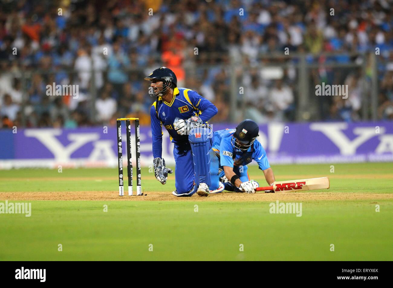 batsman Gautam Gambhir L successfully reaches run attempt wicketkeeper ICC Cricket World Cup 2011 Wankhede Stadium - Stock Image