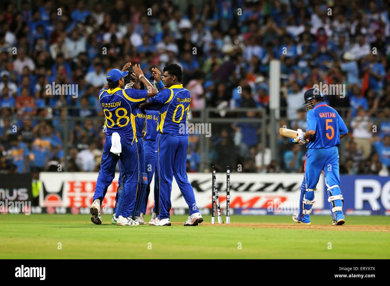 Sri Lankan team members celebrate wicket batsman Gautam Gambhir 2011 ICC World Cup Final Wankhede Stadium Mumbai - Stock Image