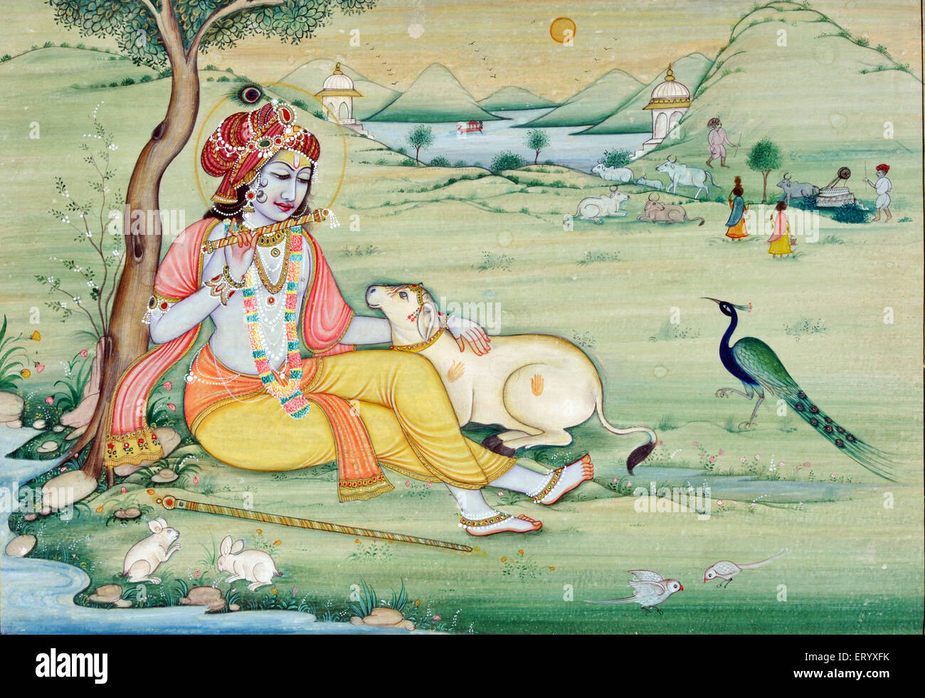Miniature painting of krishna playing flute - Stock Image