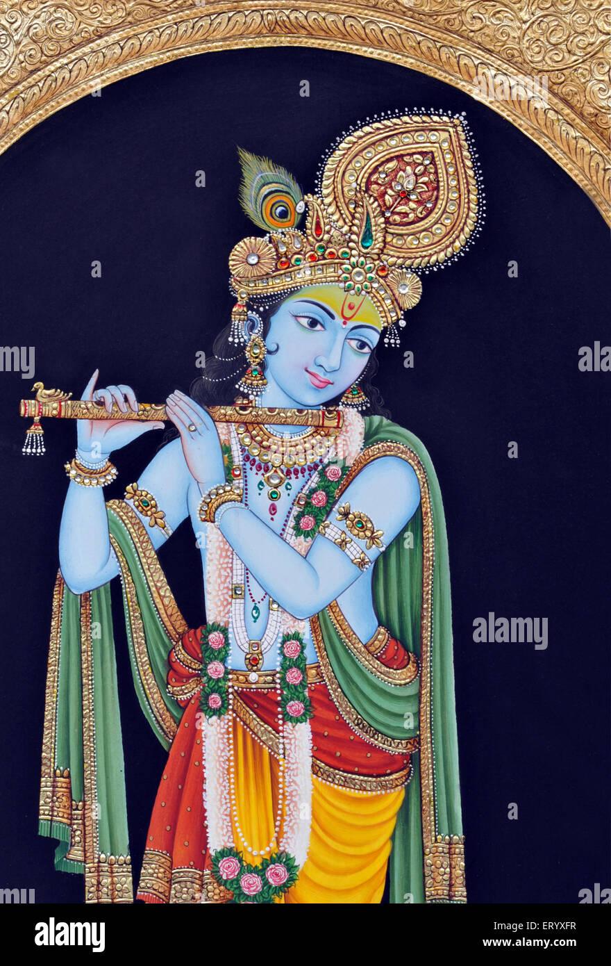 God Krishna playing flute Miniature painting India - Stock Image