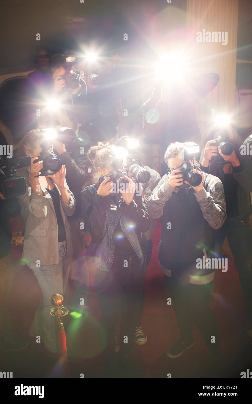 Lens flare flash from paparazzi photographers cameras - Stock Image