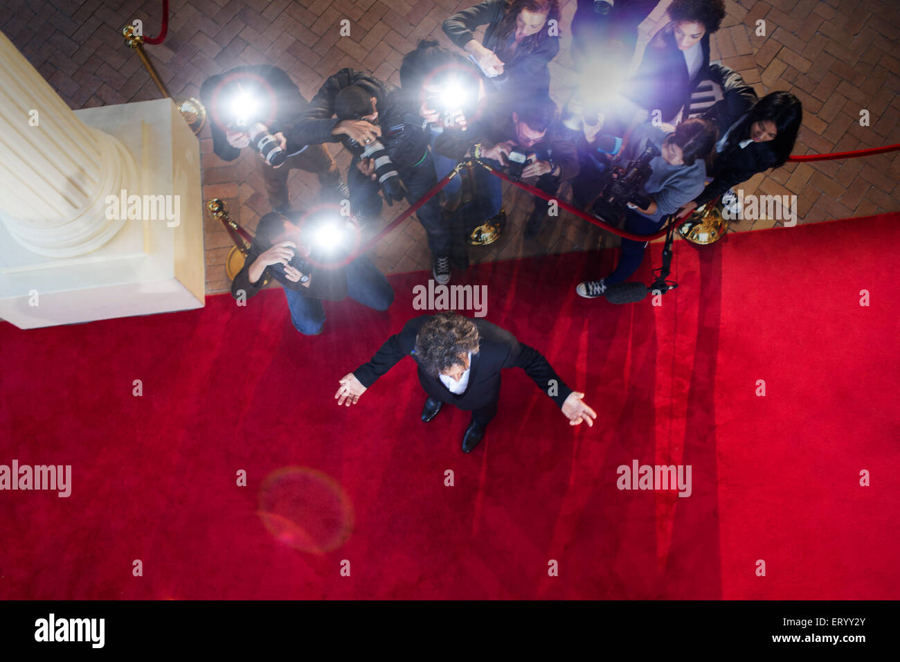 Paparazzi photographers photographing celebrity at red carpet event - Stock Image