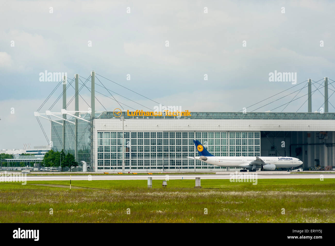 Lufthansa Airplane in front of Hangar - Lufthansa Technik - Stock Image