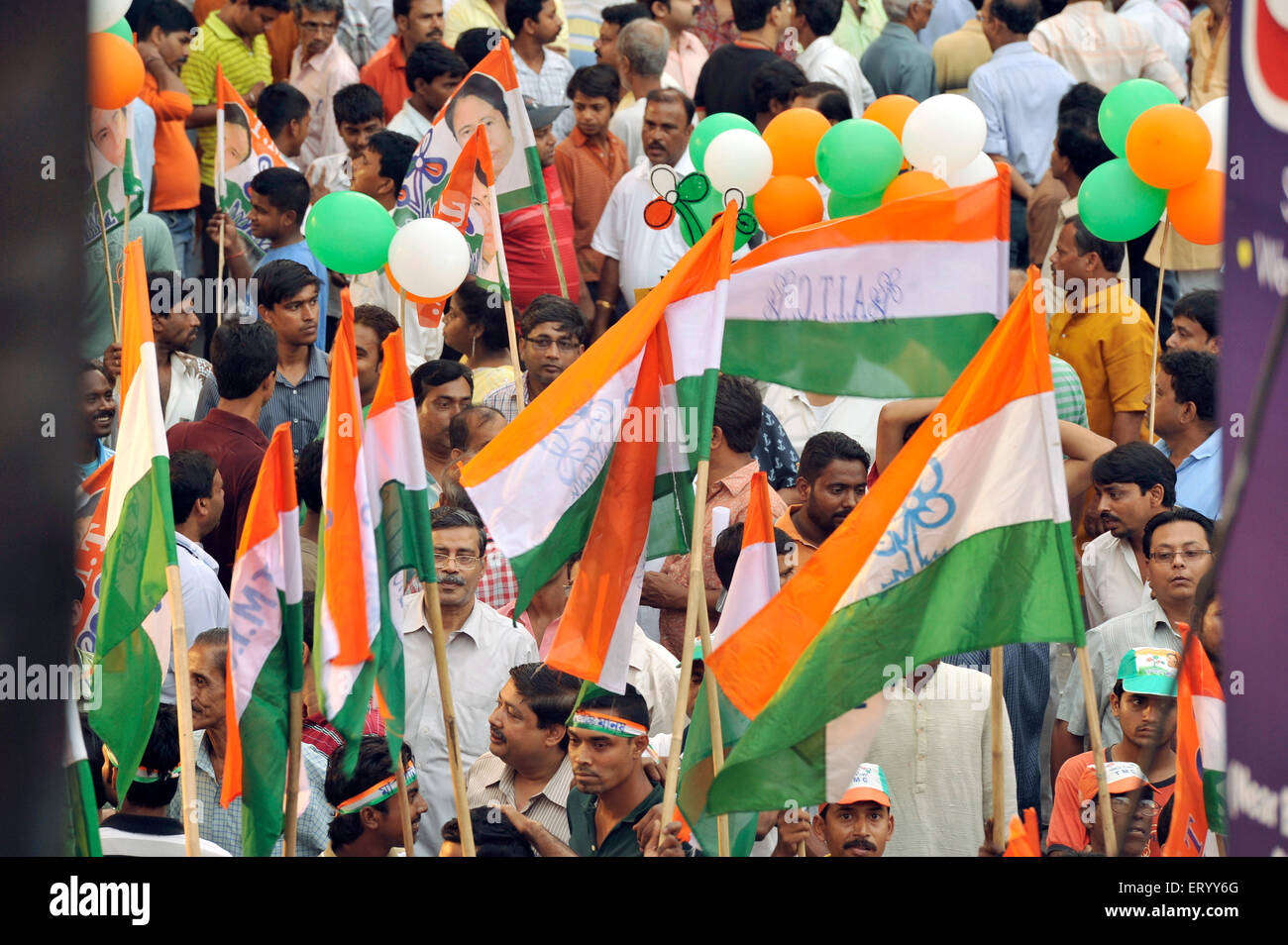 The Iconic image of Mamta Banerjee on the T M C banner in the Rally at Gariahat Road junction Kolkata India - Stock Image