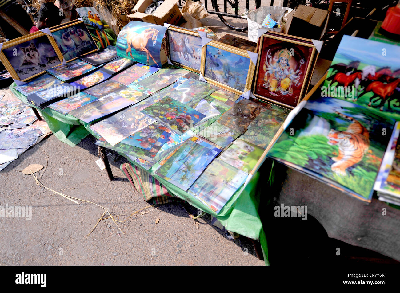 Wall photos displayed for the Summer sale at the Sunday Market Kolkata India - Stock Image