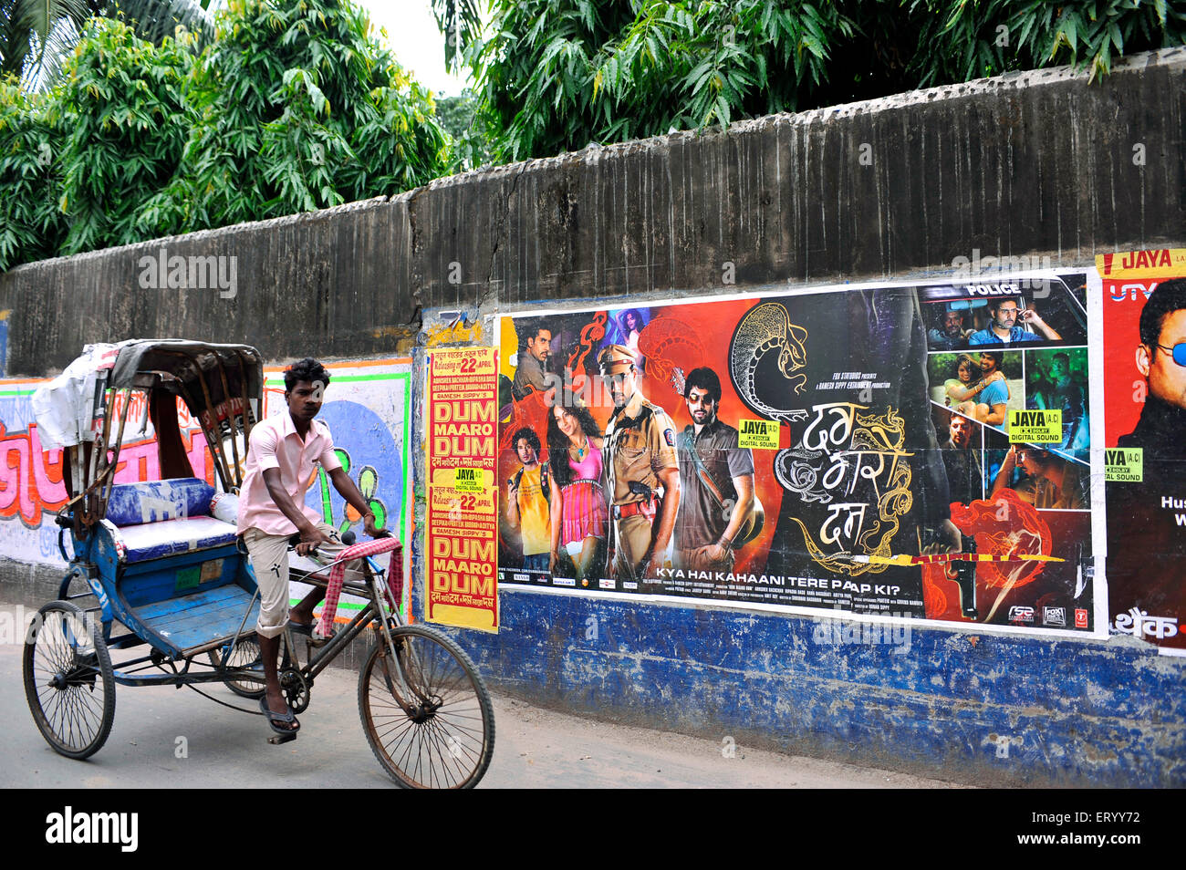 Election poster of candidates at  Kolkata India competing with cycle rickshaws Film posters - Stock Image