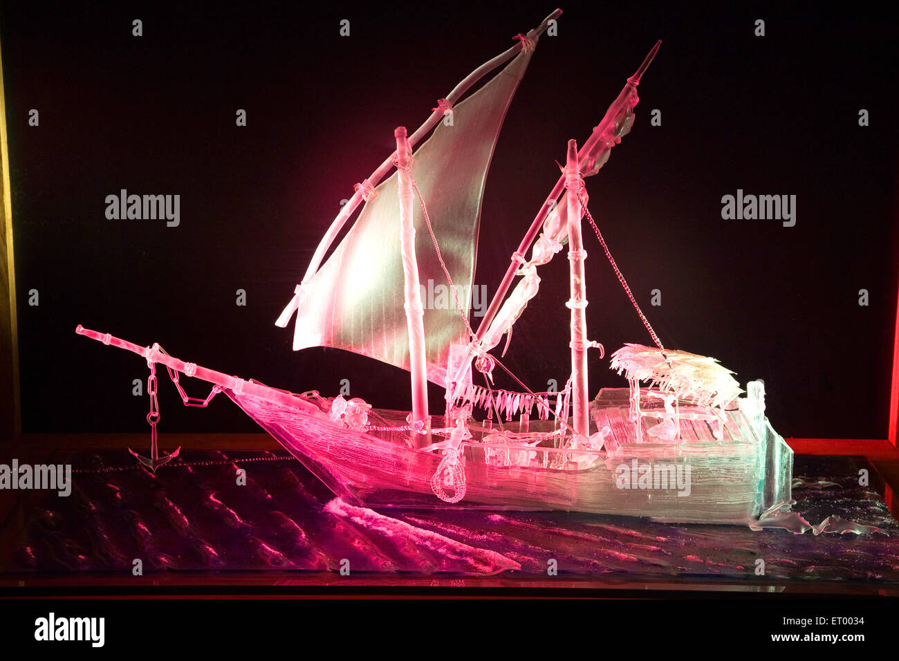 Sculpture of ship glass art on black background - Stock Image