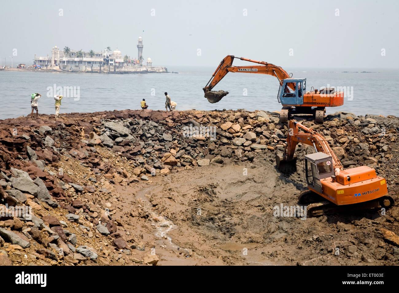 bulldozer at construction site haji ali ; Bombay Mumbai ; Maharashtra ; India - Stock Image