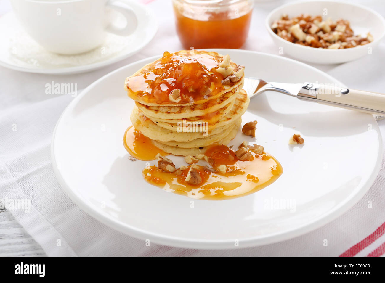 Stack of pancakes with apricots, dessert - Stock Image