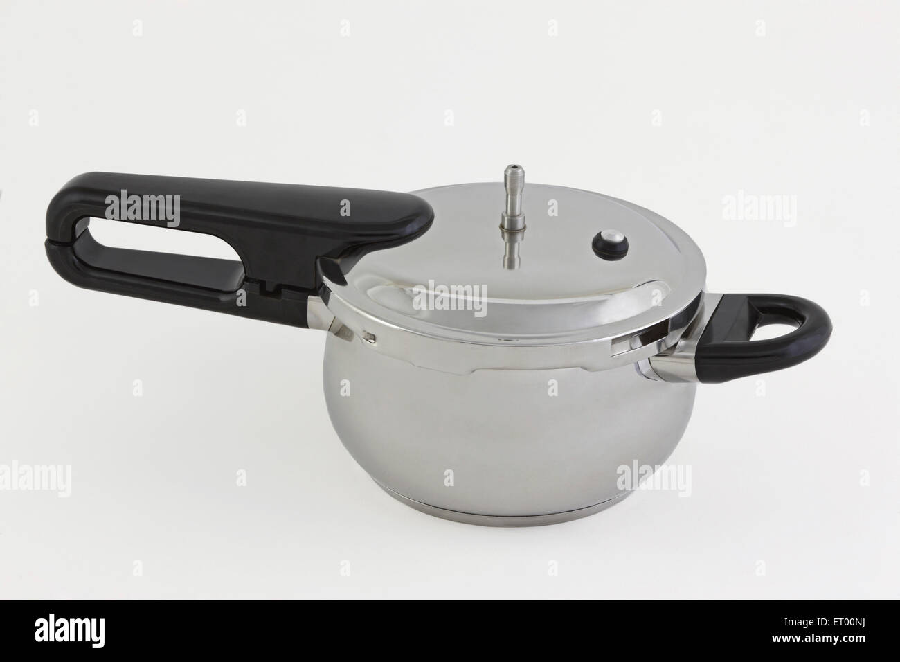 Pressure cooker ; stainless steel ; kitchen ware ; India - Stock Image
