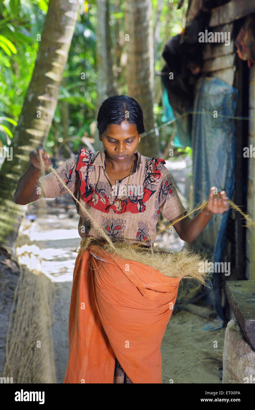Keralite woman making coir rope in cottage ; traditional method ; Kerala ; India NO MR Stock Photo