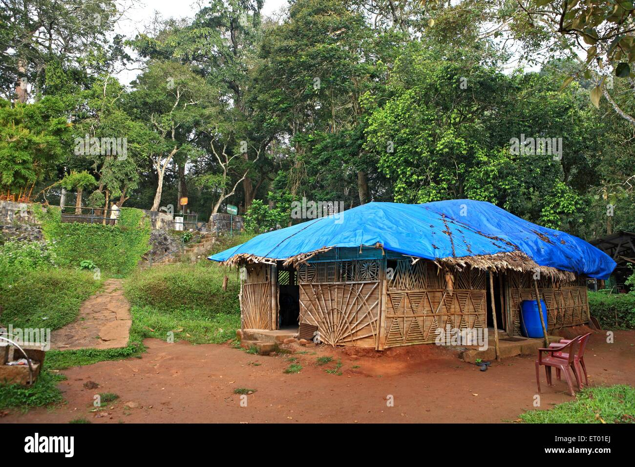 Bamboo hut with blue roof covering at Periyar tiger reserve ; Thekkadi ; Kerala ; India - Stock Image