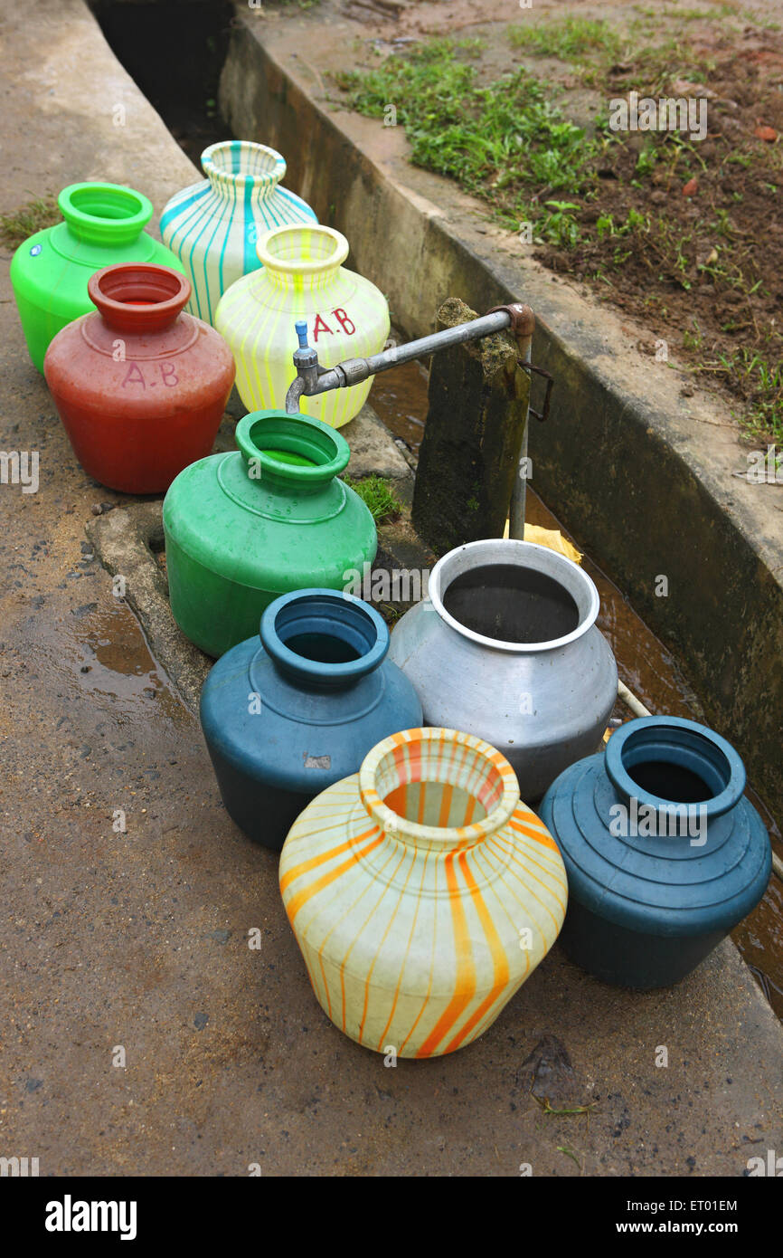 Empty containers queue for water ; Thekkady ; Kerala ; India - Stock Image