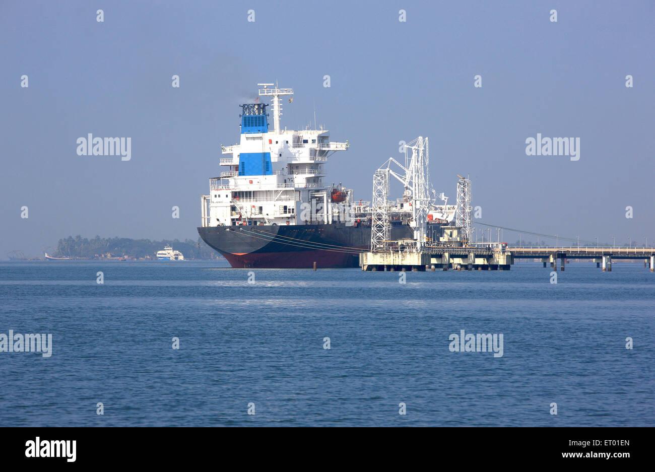 Oil tanker ship anchored ; Cochin Kochi harbour jetty ; Kerala ; India - Stock Image
