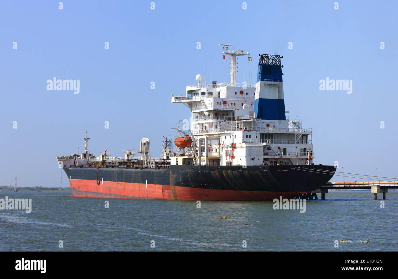 Oil tanker ship anchored at Cochin Kochi harbour jetty ; Kerala ; India - Stock Image
