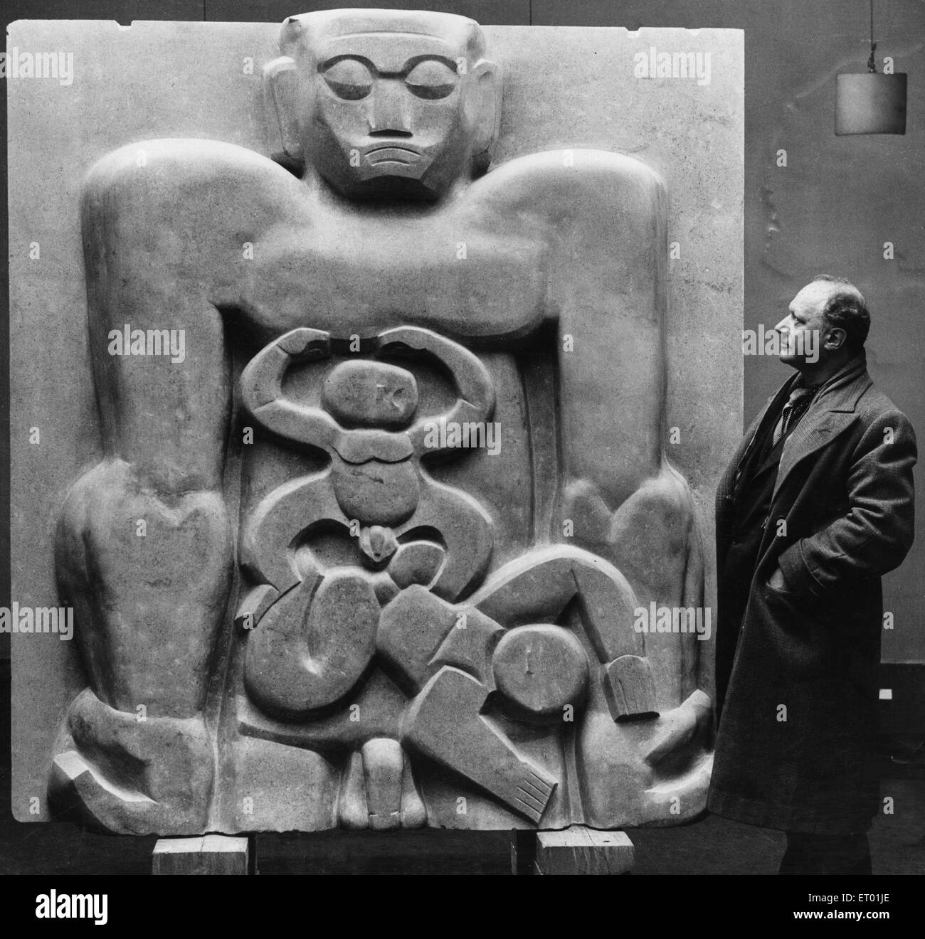 Sculptor Jacob Epstein seen here at the Leicester Square Gallery with his piece Primeval Gods. 26th April 1933 - Stock Image