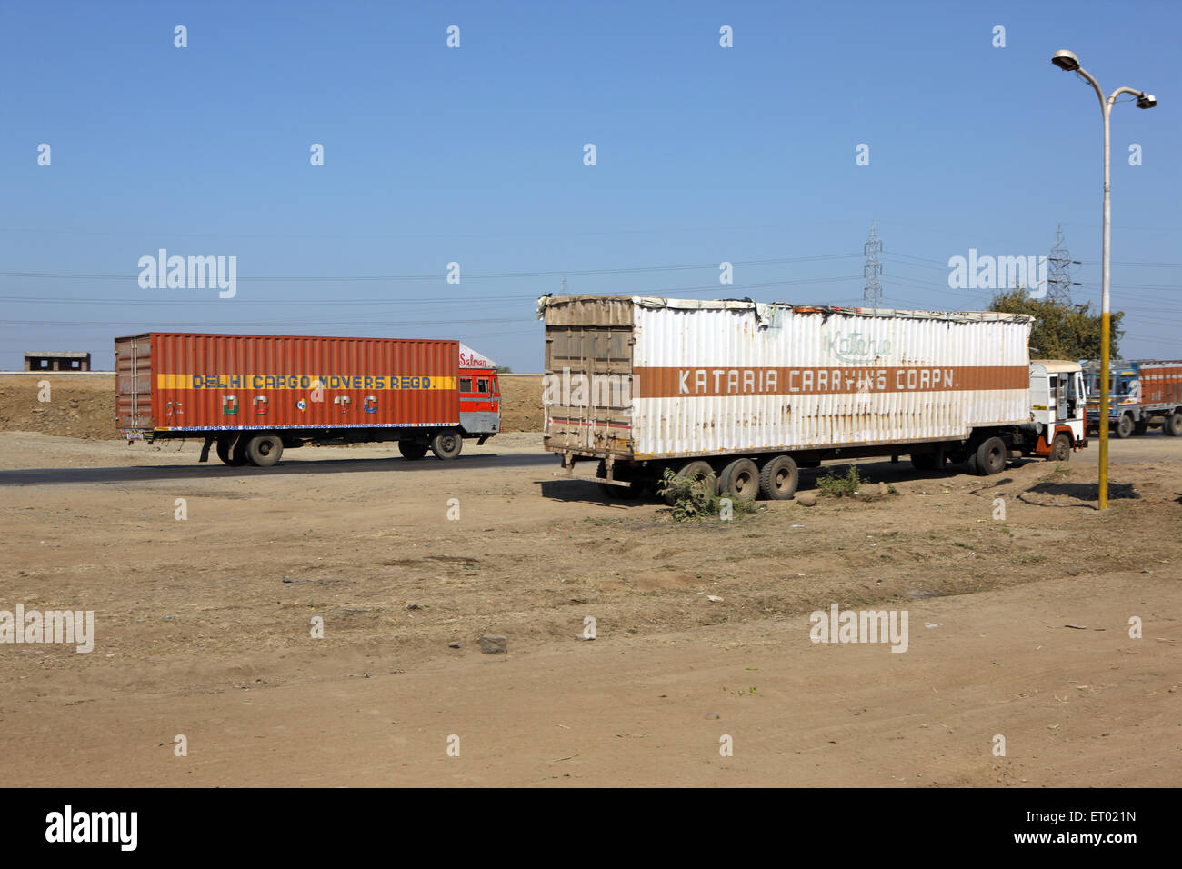 Transporting of containers on state highway - Stock Image