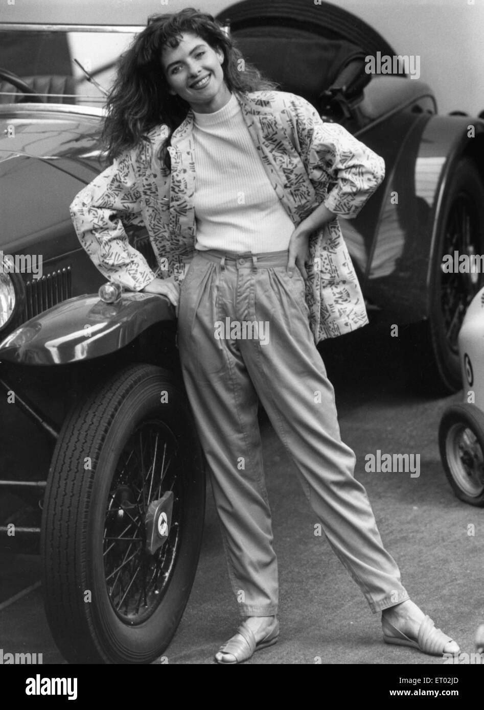 1980s Fashion Model Wears Apple Green Trousers With White Pattern Jacket Standing Beside A