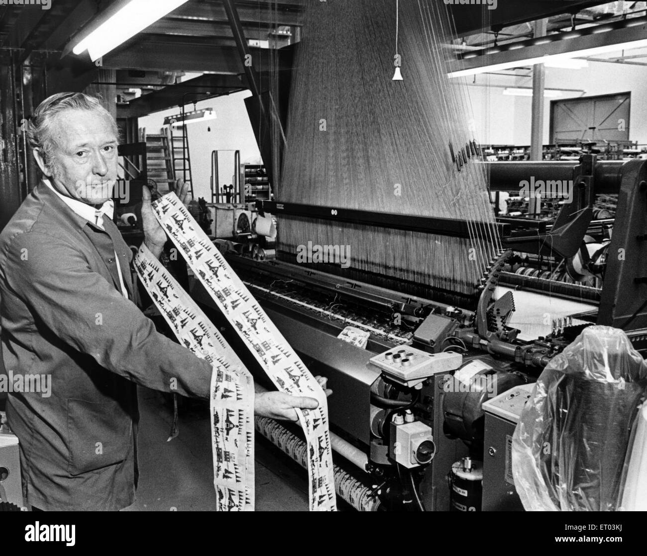 Within days tasks which used to take weeks are completed and one of the 11 new swiss looms is reproducing pictures - Stock Image