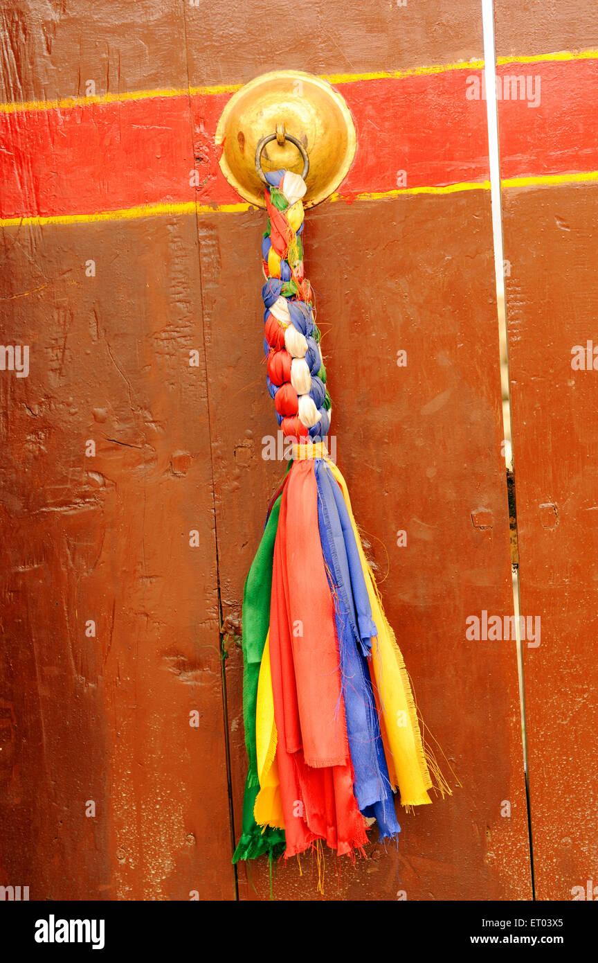 Colourful door handle braided ribbon ; Jharkot ; Nepal - Stock Image
