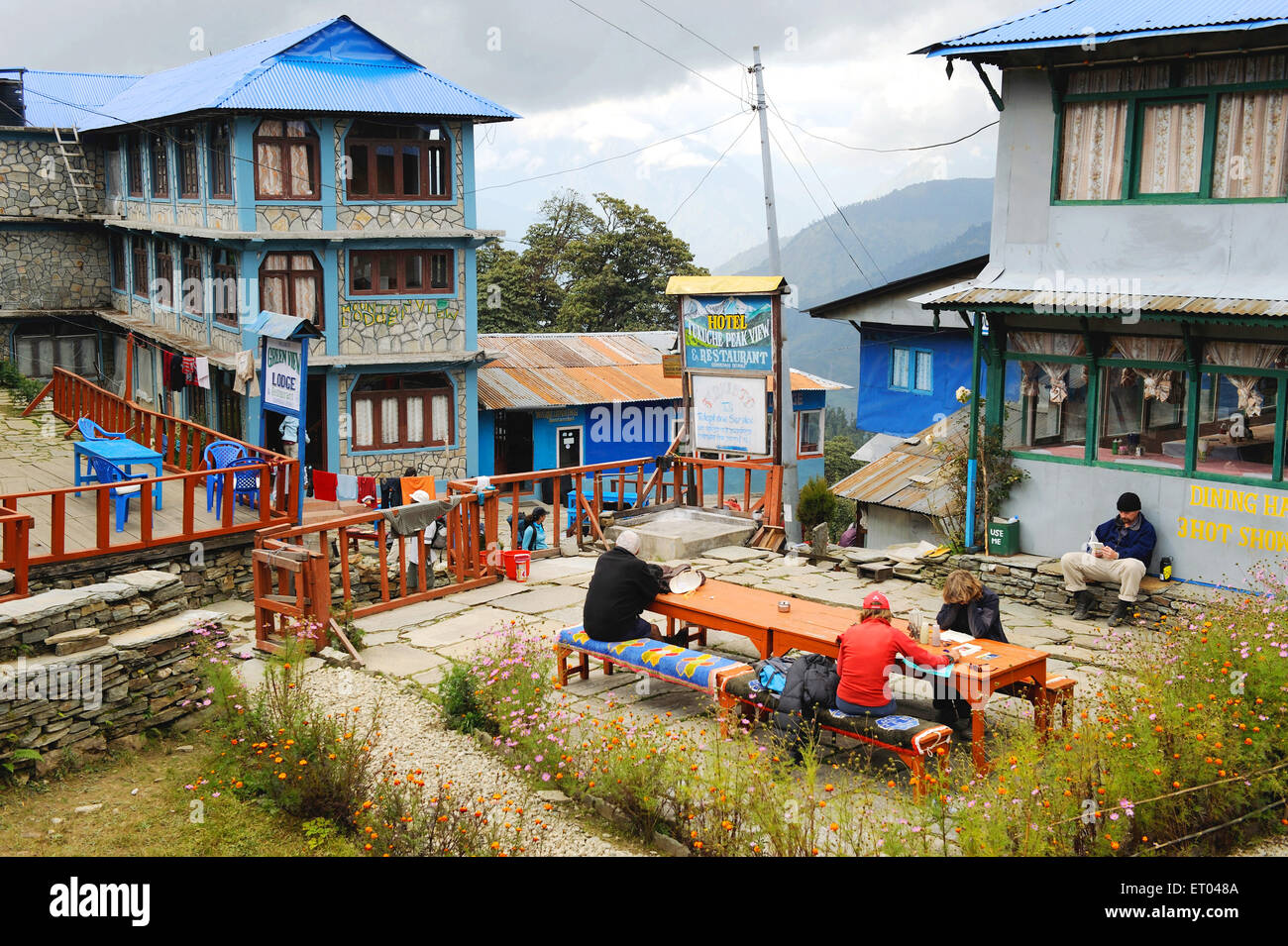 Tourists on dining table at hotel ; Ghoripani ; Nepal - Stock Image