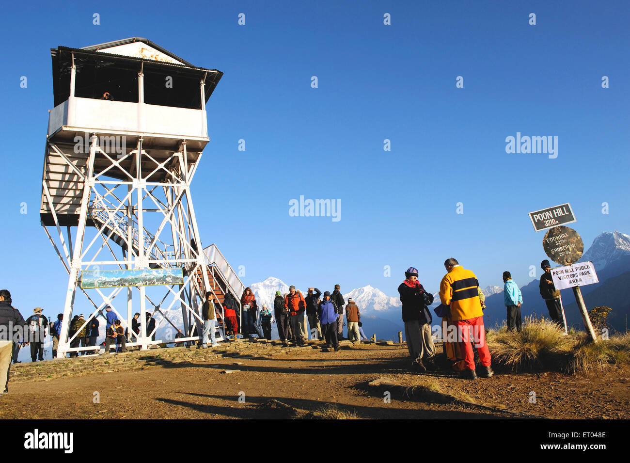 Trekkers at watch tower poon hill signboard ; Ghoripani ; Nepal - Stock Image
