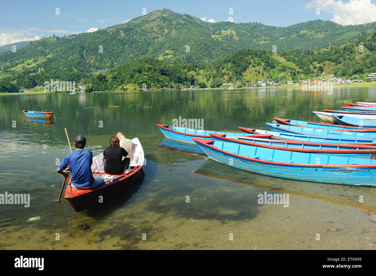 Tourists in boat at lake phewa ; Pokhara ; Nepal - Stock Image