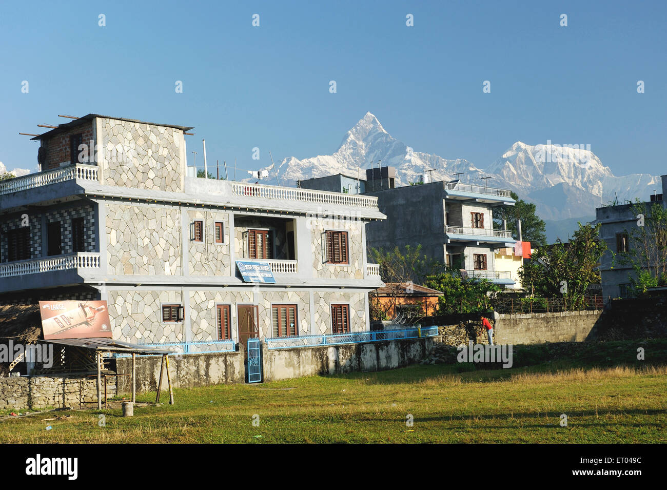 Houses at snow peaks ; Pokhara ; Nepal - Stock Image
